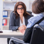 Injured employee visiting law firm for car accident injury claim