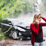 young woman on phone after car accident